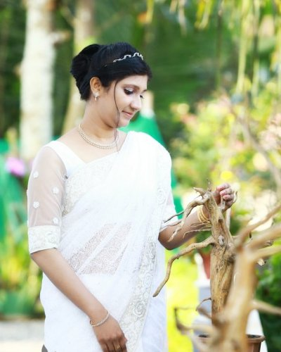 Adorable bride with in white saree - feathertouch beauty salon, pathanamthitta