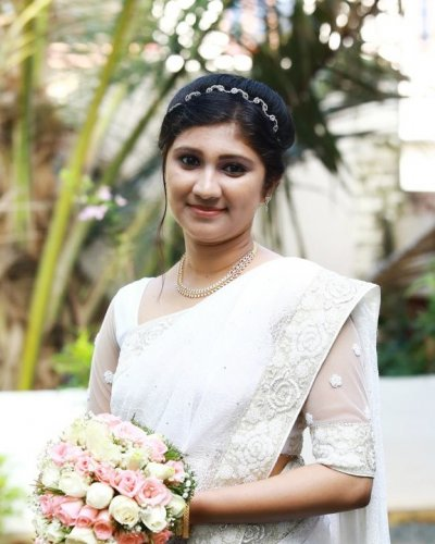 Adorable bride in white saree - feathertouch beauty salon, pathanamthitta